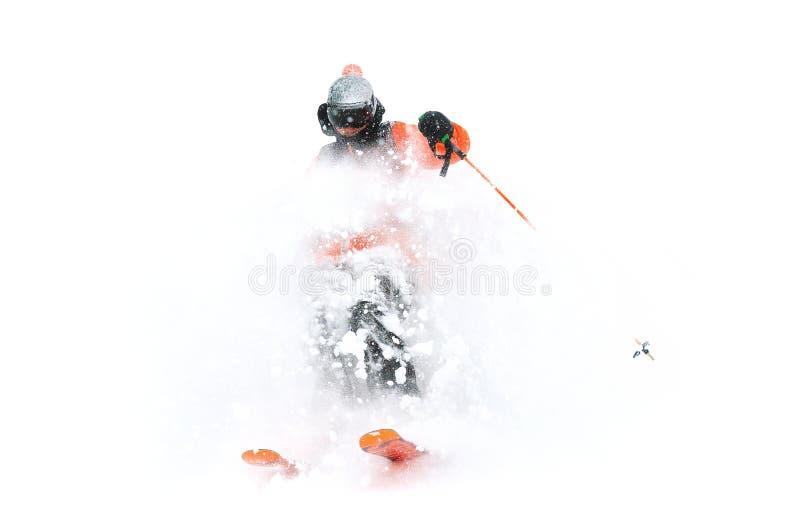 Yrkesmässiga skidåkareidrottsman nenritter ut ur djup snö, medan utföra ett skida trick i en snöstorm Vintersäsongen är royaltyfri fotografi