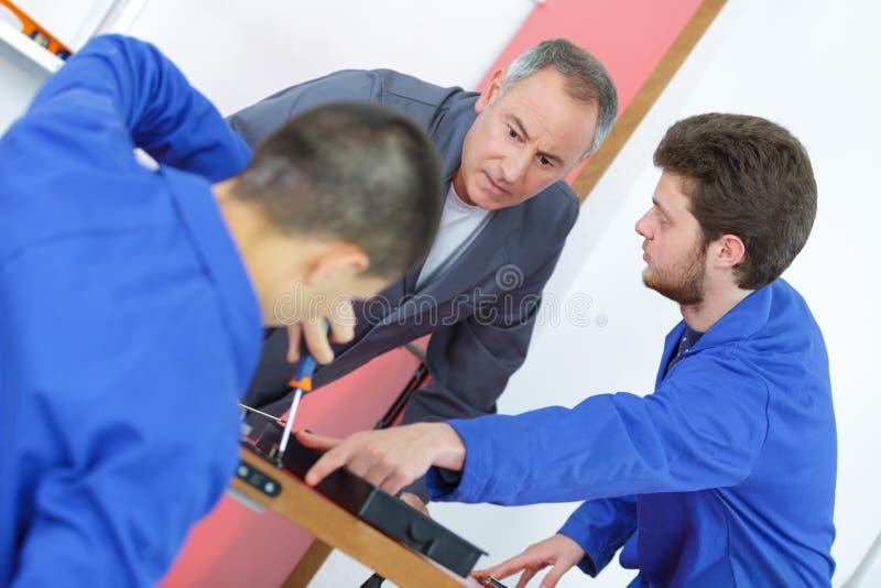 Yrkesutbildning med två studenter royaltyfri bild