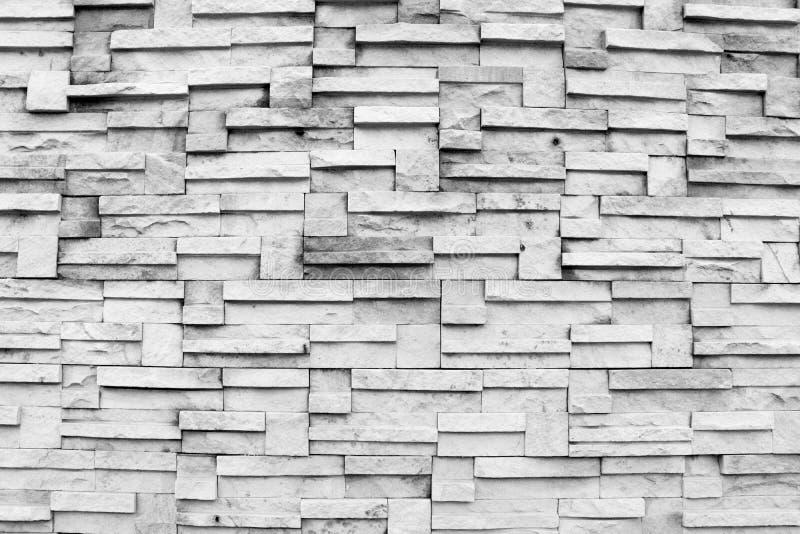Ytbehandla den svartvita väggen av bakgrund för stenväggen arkivfoton