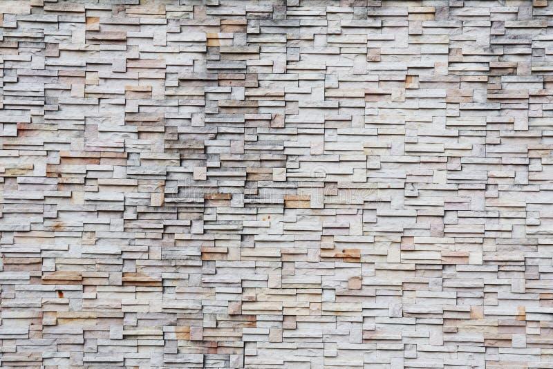 Ytbehandla den vita väggen av bakgrund för stenväggen fotografering för bildbyråer