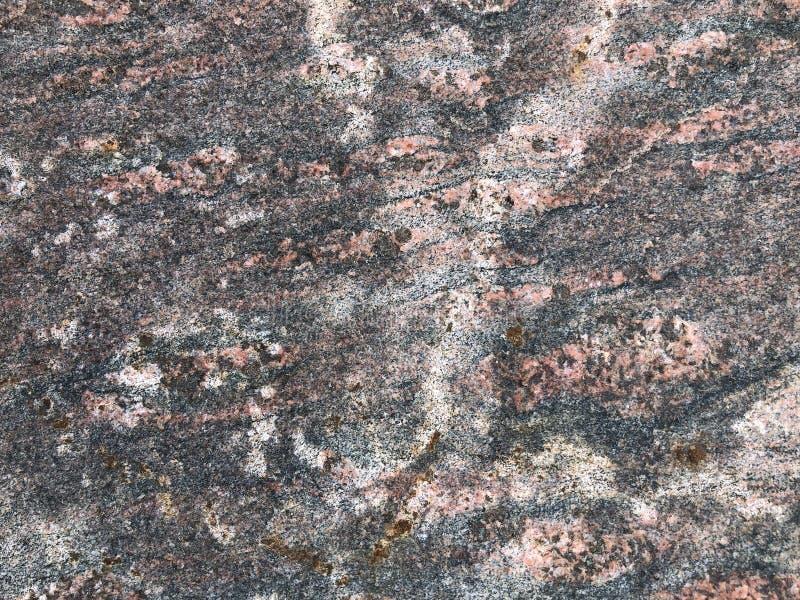 Yttersida av den naturliga granitstenen arkivfoton