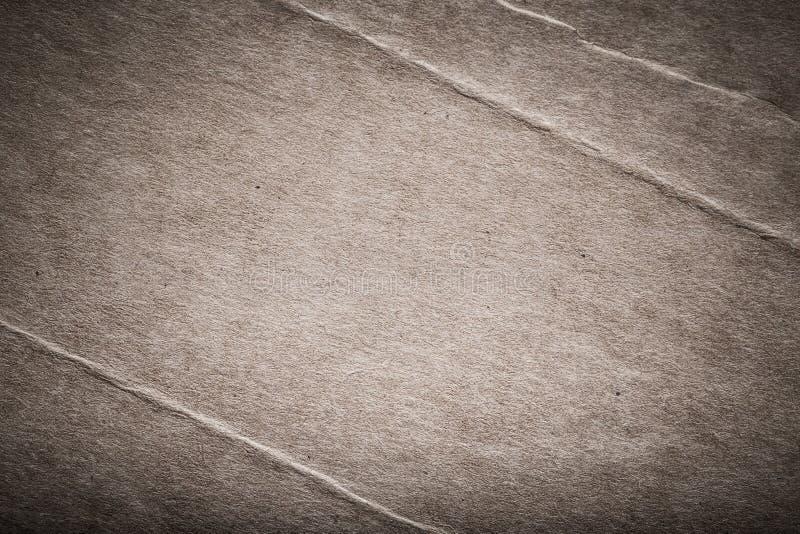 Yttersida av gammalt papper för texturerad bakgrund tonat arkivfoton