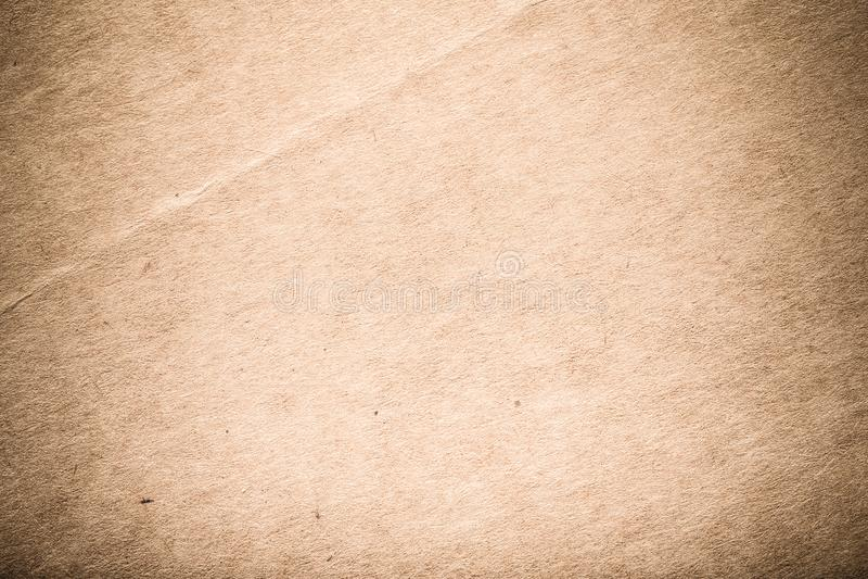 Yttersida av gammalt papper för texturerad bakgrund tonat royaltyfria foton