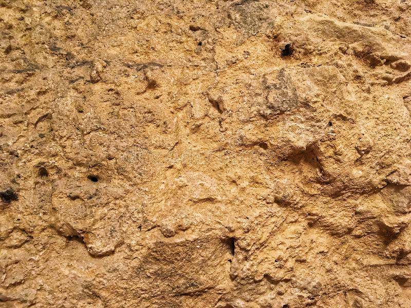 Yttersida av naturlig beige sandsten, textur arkivbilder