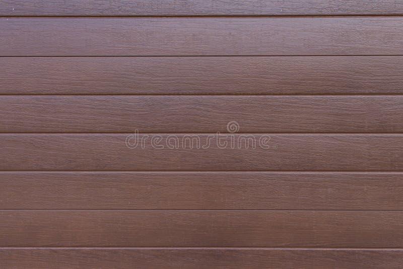Yttersida för bakgrund för panel för texturträplanka rödbrun royaltyfria bilder
