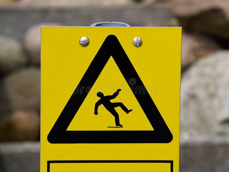 Yttersida för golv för varningstecken hal arkivfoton