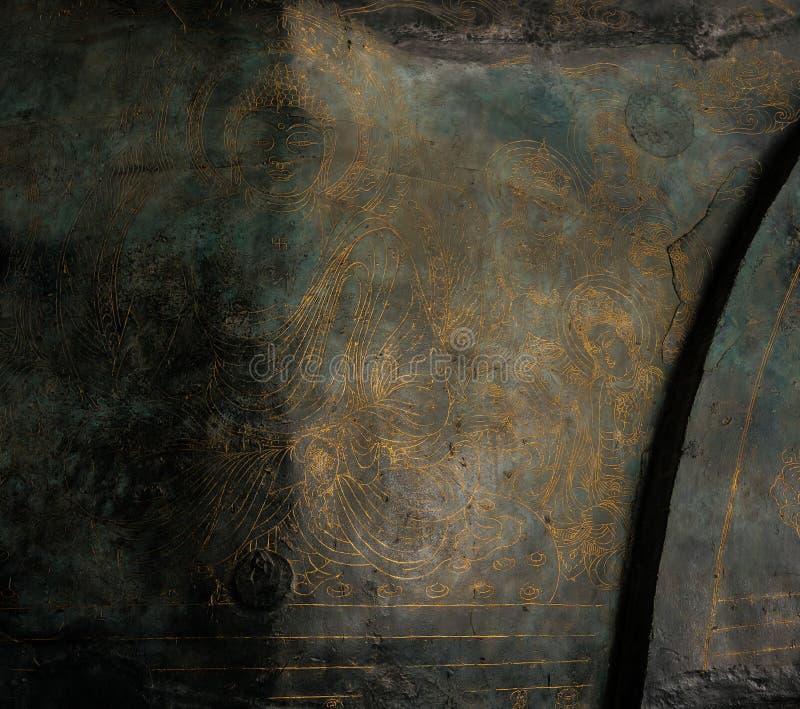 Yttersidor för bronslotusblommakronblad som etsas och inristas med bilder av sakrala beings arkivbild