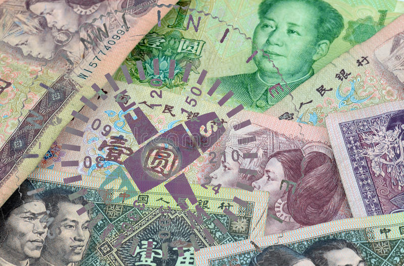 YUAN compass. Yuan - the Chinese currency renminbi banknotes with a compass scene royalty free stock images