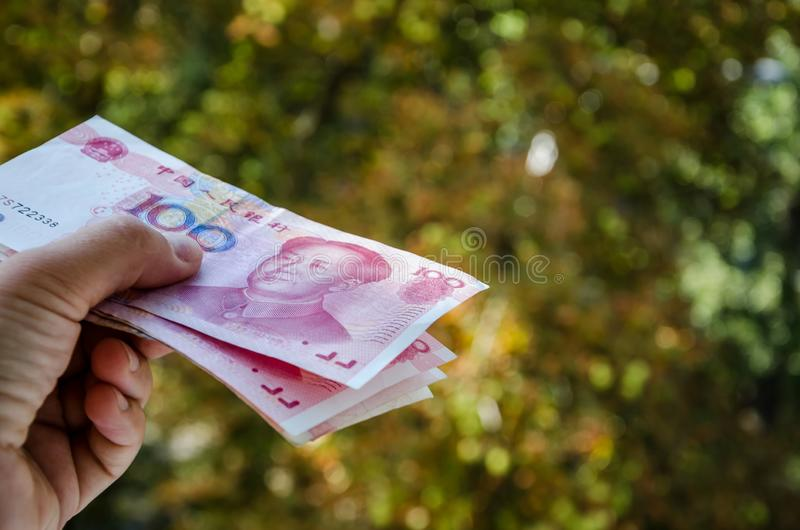 Yuan in the hand. Chinese money close-up. Chinese money in hand close up stock photos