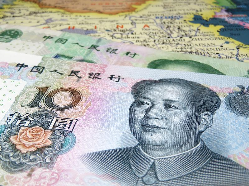 Yuan on the map of China. Chinese currency renminbi. Yuan banknotes, Economy of China concept, trade war royalty free stock photos