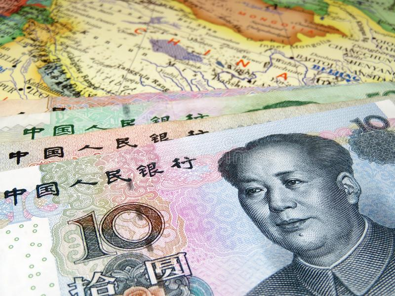 Yuan on the map of China. Concept for chinese economy, trade war between US and China, economic sanctions royalty free stock photos