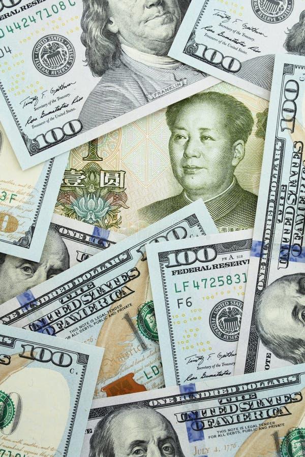 Yuan vs dollars. Yuan among one hundred dollars stock image