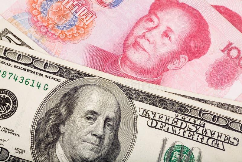 Yuan y dólar chinos fotos de archivo libres de regalías