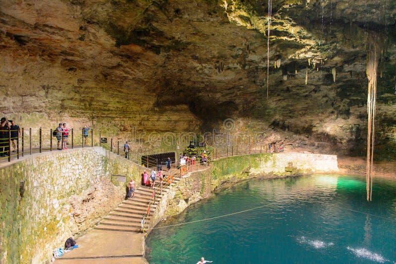 Dark cenote (water reservoir) underground in Yucatan, Mexico royalty free stock photos