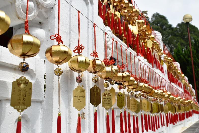 golden bell donation and writing name for luck hanging on wall in Xuanguang Temple sun moon lake stock photos
