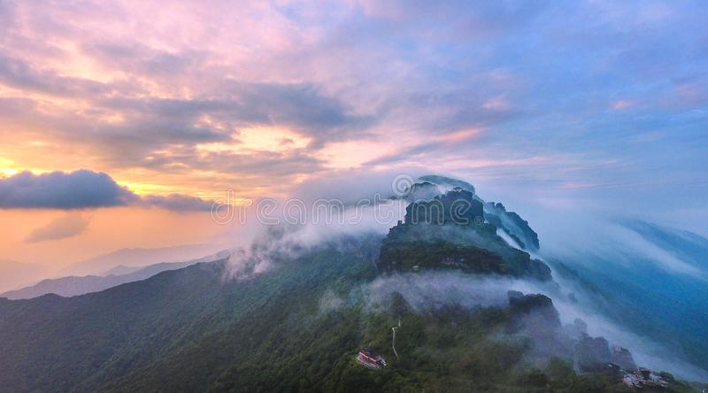 A temple at sunset. The yuejin hill temple at sunset of fanjingshan nature reserve in guizhou of china. The hongyun hill temples in the clouds of morning, in royalty free stock photo