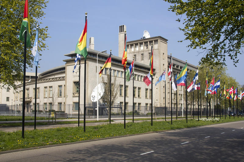 Yugoslavia Tribunal. International flags in front of the UN Tribunal for war crimes in the former Yugoslavia royalty free stock photo