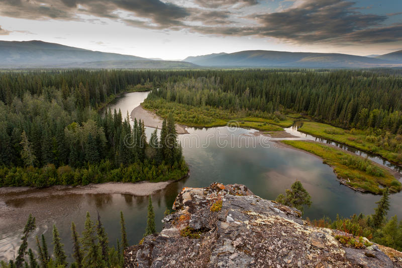 Yukon Canada taiga wilderness and McQuesten River royalty free stock photo