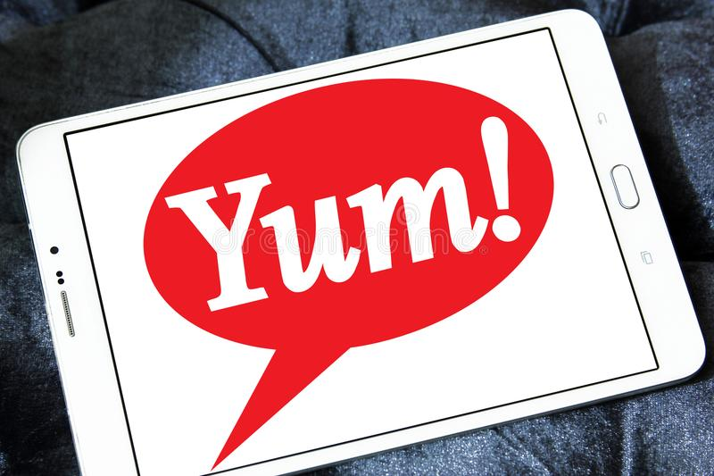 Yum! Brands logo. Logo of Yum! Brands on samsung tablet . is an American fast food company. A Fortune 500 corporation, Yum! operates the brands Taco Bell, KFC royalty free stock images