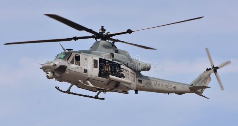 Marine Corps UH-1Y Venom. Yuma, USA - March 9, 2018: A U.S. Marine Corps UH-1Y Venom attack helicopter flying at MCAS Yuma. This UH-1Y Venom belongs to the VMX-1 royalty free stock photography