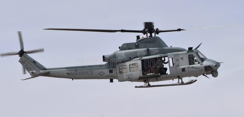Marine Corps UH-1Y Venom. Yuma, USA - March 9, 2018: A U.S. Marine Corps UH-1Y Venom attack helicopter flying at MCAS Yuma. This UH-1Y Venom belongs to the VMX-1 royalty free stock photo