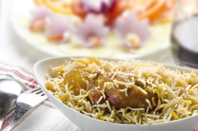 Yummy biryani with salad and rita royalty free stock image