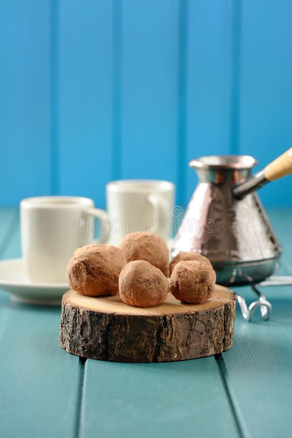 Download Yummy Chocolate Sweets On Wood Slabs With Cezve And Coffee Cups Stock Photo - Image: 83710775