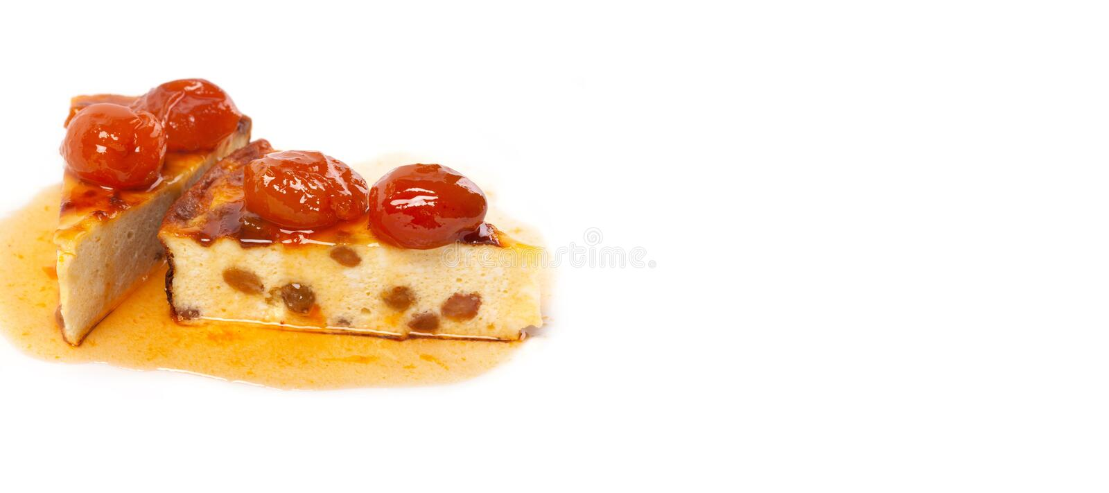 Yummy dessert Cottage cheese casserole on white background. Homemade sweet pudding delicious cake with raisins and. Apricot berries sauce. Copy space royalty free stock images