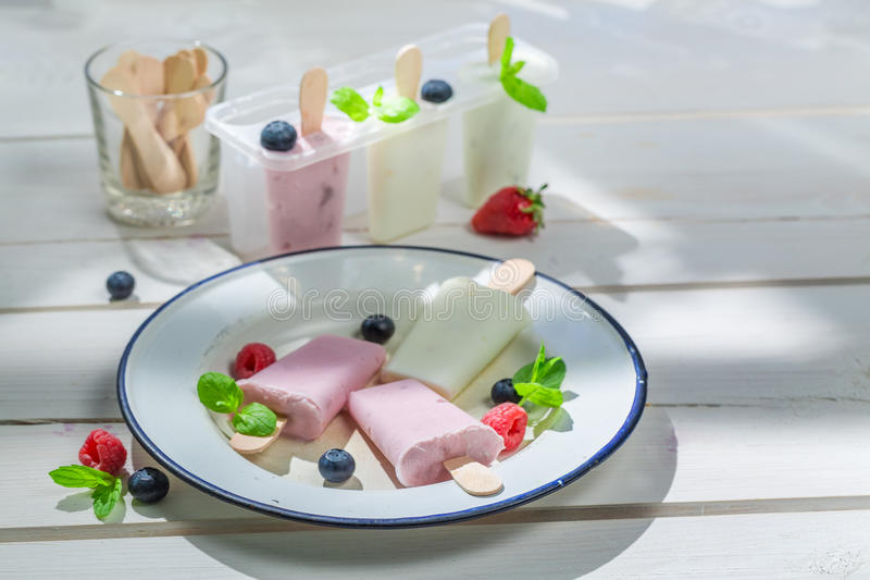 Yummy ice cream with milk and fruits stock image