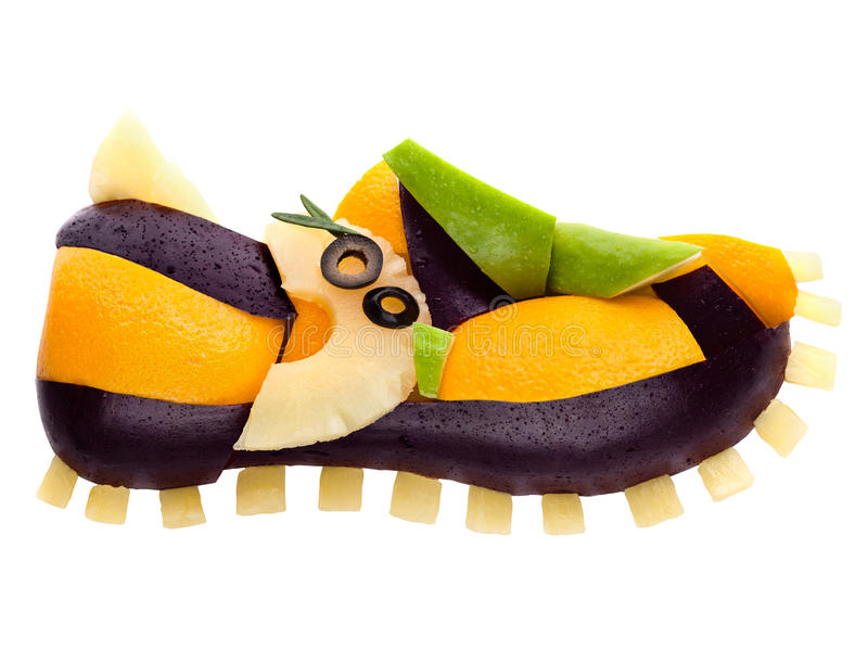 Yummy sneaker. Fruits and vegetables in the shape of a shoe strainer isolated on white royalty free stock image
