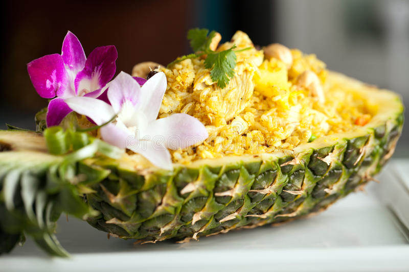 Yummy Thai Pineapple Fried Rice. Freshly prepared pineapple fried rice served inside of a pineapple carved like a bowl royalty free stock images