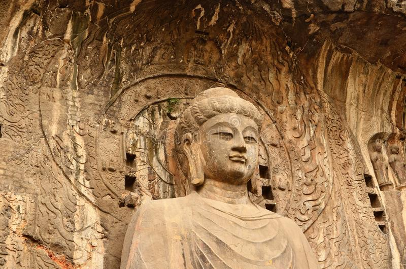 Yungang Grottoes. The Yungang Grottoes, formerly the Wuzhoushan Grottoes, are ancient Chinese Buddhist temple grottoes near the city of Datong in the province of stock photo