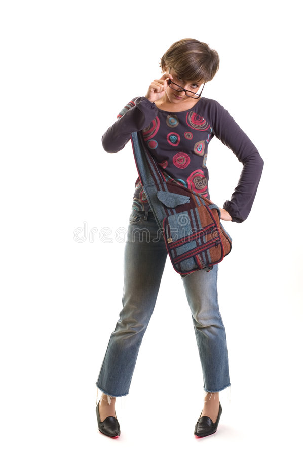 Download Yuppie Girl Standing Fixing Glasses Stock Photo - Image: 1532266