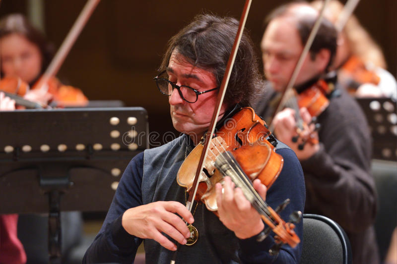 Yuri Bashmet on the rehearsal. Novosibirsk, Russia - December 5, 2014: Yuri Bashmet and ensemble Moscow Soloists on the rehearsal during the festival Classics royalty free stock image