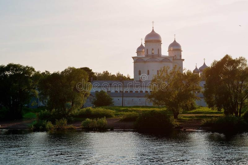 Yuriev male monastery on the bank of the Volkhov river at sunset in Veliky Novgorod, Russia - architecture landscape stock images