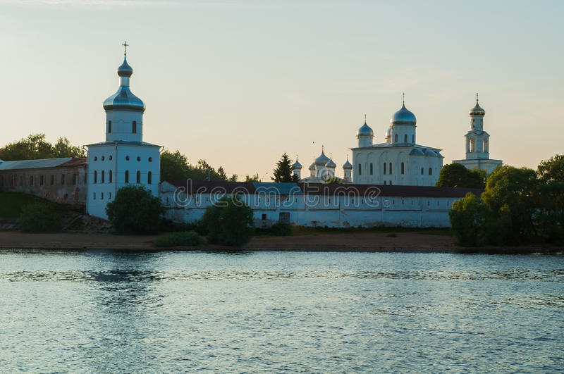 Yuriev monastery on the bank of the Volkhov river at summer suns royalty free stock images