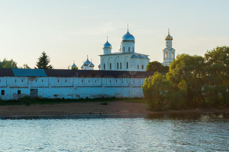Yuriev monastery on the bank of the Volkhov river at summer sunset in Veliky Novgorod, Russia royalty free stock images