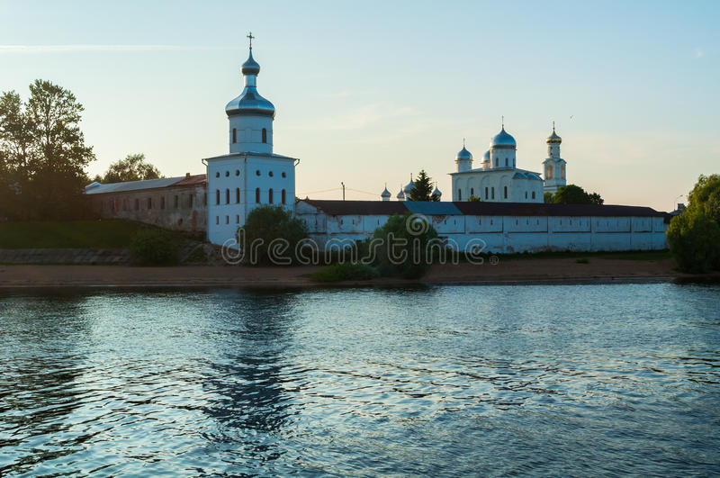 Yuriev monastery on the bank of the Volkhov river at sunset in Veliky Novgorod, Russia royalty free stock photography