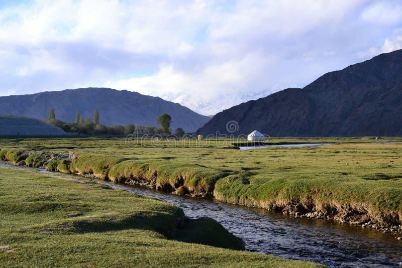 Yurt with river in Tashkurgan and mountains, Xinjiang, China royalty free stock images