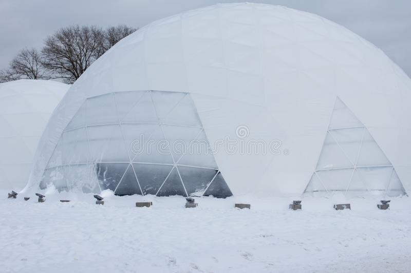 Yurt round house built of ice in the North. The house of the Eskimos of blocks of ice royalty free stock photo