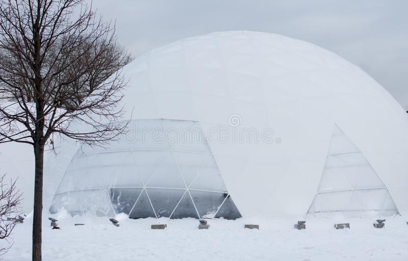 Yurt round house built of ice in the North. The house of the Eskimos of blocks of ice royalty free stock image