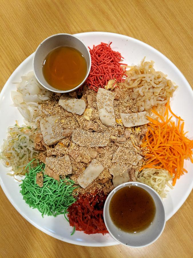 Yusheng dish during Chinese New Year. Traditional practice in Malaysia and Singapore stock image