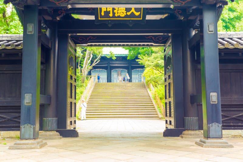 Yushima Seido Confucian Temple Entrance Doors H. Stairs seen through open entrance doorway to historic Yushima Seido, a Confucian temple in Tokyo, Japan stock photo