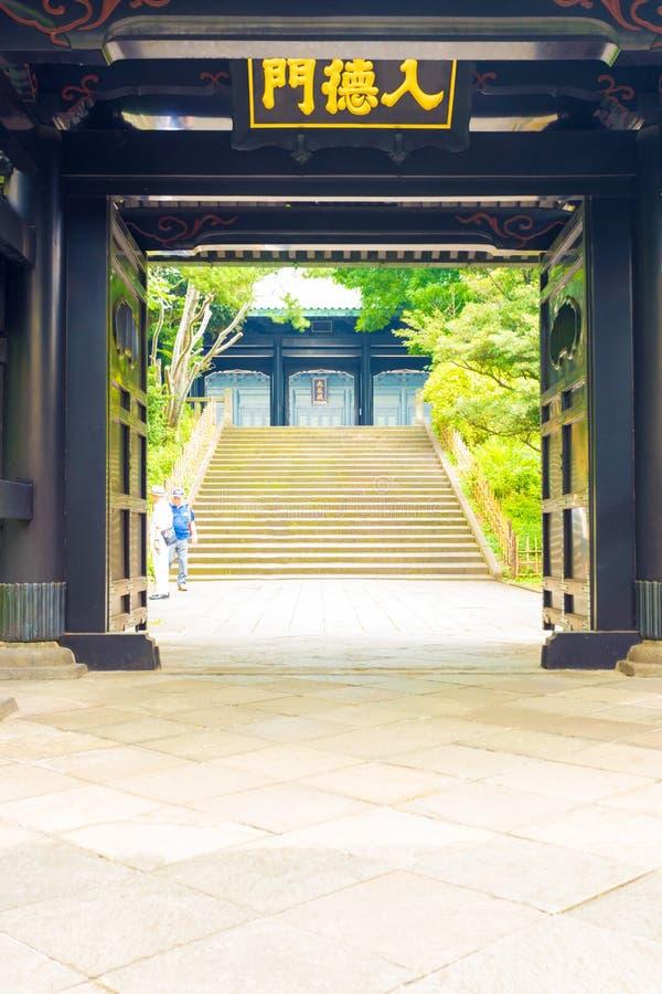 Yushima Seido Confucian Temple Entrance Doors V. Stairs seen through open entrance doors to historic Yushima Seido, a Confucian temple in Tokyo, Japan. Vertical stock image