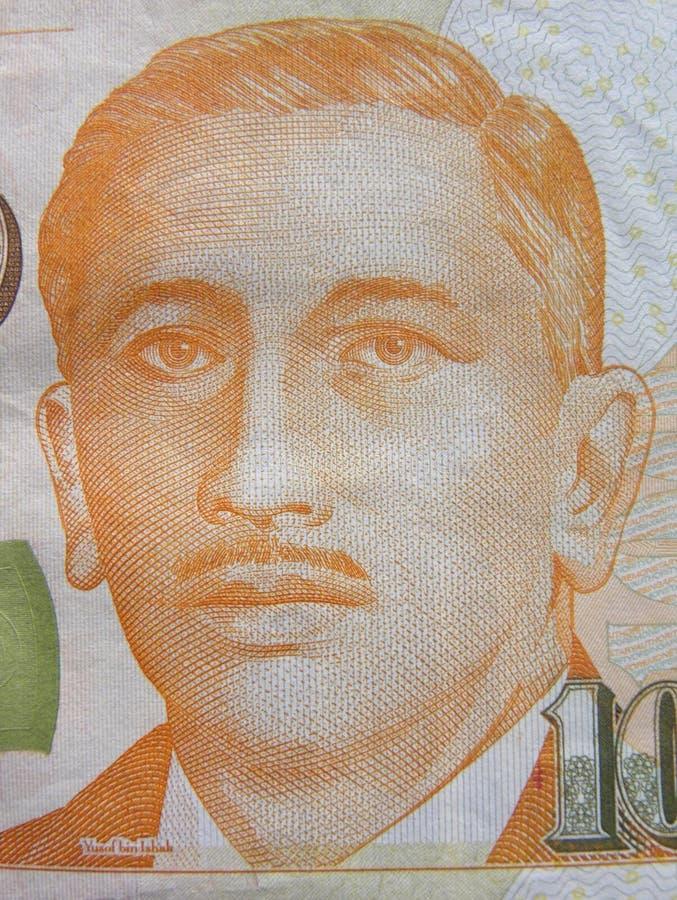 Yusof bin Ishak Portrait on 100 dollars banknote. Orange color portrait of president Yusof bin Ishak on hundred dollars Singapore banknote stock photos