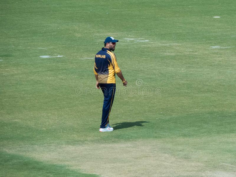 Yuvraj Singh Cricketer Walking Off the field. Indian international cricketer Yuvraj Singh fielding in T-20 Cricket Match played at Holkar Stadium Indore. Railway royalty free stock image