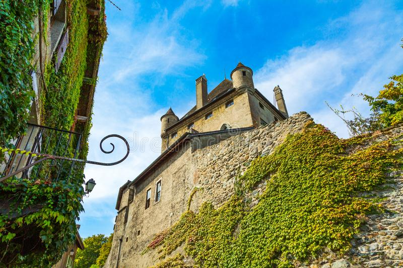 Yvoire medieval town and its defensive castle tower, France royalty free stock photography