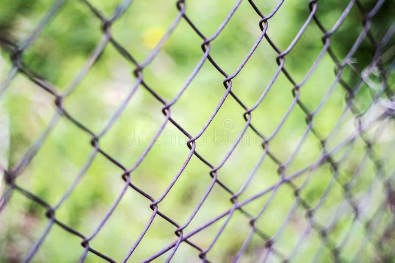 Z?unen Sie Filetarbeit, Konzept der Grenze ein, damit ein Zaun zugeschlossen werden kann Schlie?en Sie herauf Muster Barb Wire lizenzfreies stockbild