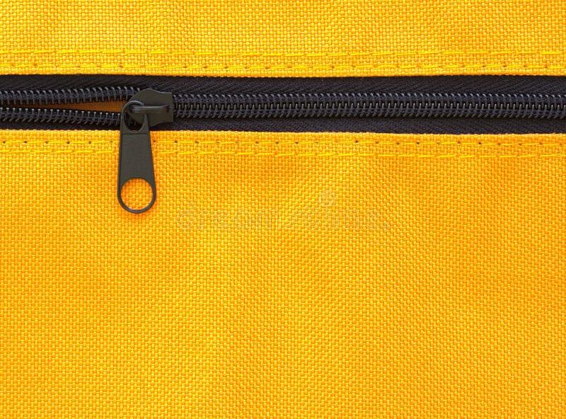Zíper no saco amarelo imagens de stock