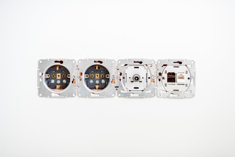 Zócalos eléctricos en la pared fotos de archivo libres de regalías